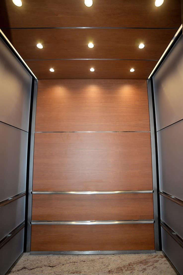 Evolving Interior Design for 3 Uniquely Sized Elevator Cabs at